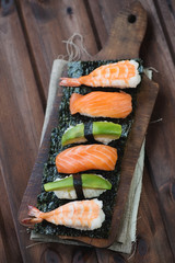 Sushi set on a rustic wooden background, studio shot