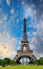 Sunset sky above Eiffel Tower - Paris. La Tour Eiffel from Champ