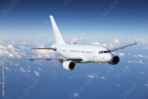 canvas print picture Flugzeug auf Reisen über den Wolken