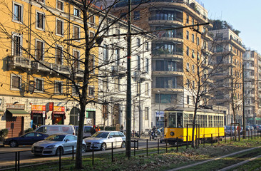 Old traditional yellow tram on the street of Milan