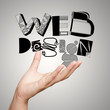 clouse up of  hand showing design word WEB DESIGN  as concept
