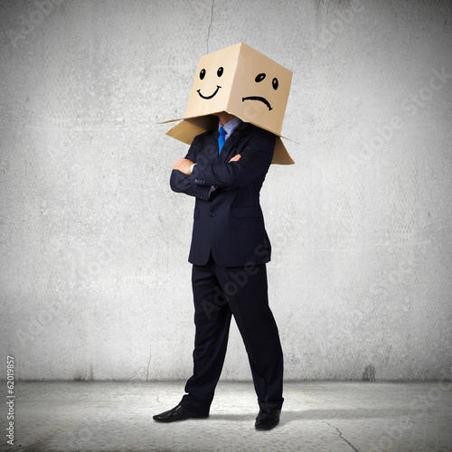 Businessman with box on head