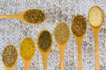 Set of spices on white leaf.