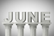 June month sign on a classic columns