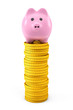 Pink piggy bank over Golden dollar coin stacks