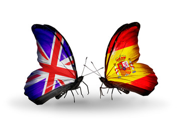 Two butterflies with flags UK and Spain