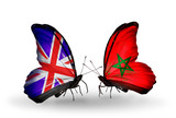Two butterflies with flags UK and Morocco