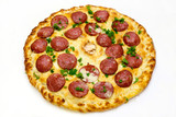 pizza with sausage and parsley