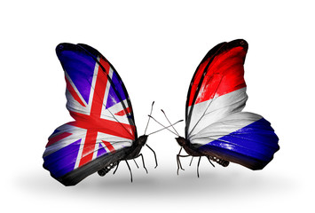 Two butterflies with flags UK and Holland