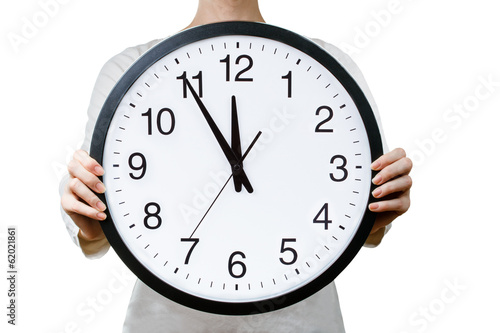 Woman holding a clock. Time management concept