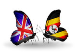 Two butterflies with flags UK and Uganda