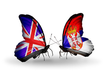 Two butterflies with flags UK and Serbia
