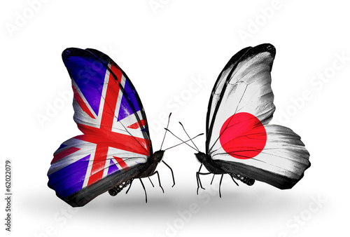 Two butterflies with flags UK and Japan