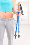 Woman holding nordic walking sticks