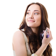Woman with perfume, young beautiful girl holding bottle of perfu