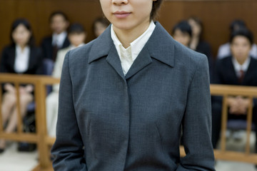 young woman taking the witness stand