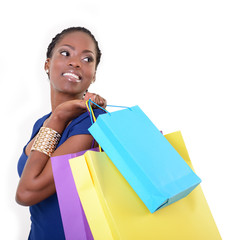 beautiful young woman african model holding colored shopping bag