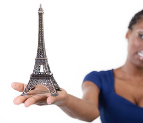 Eiffel tower - symbol of Paris - in hand of african model, over