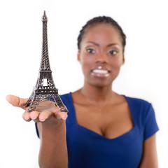 Beautiful african model holding little Eiffel tower