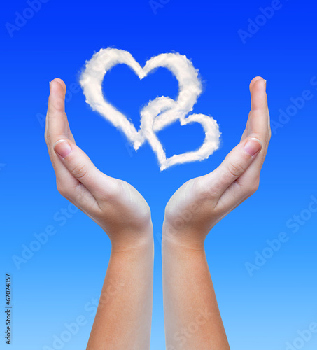 Heart from clouds in hands