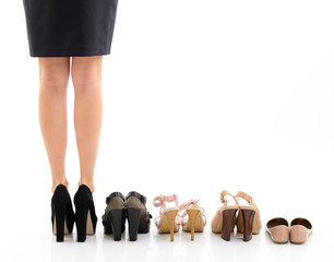 Shopping and sale. Female legs with shoes assortment, young woma