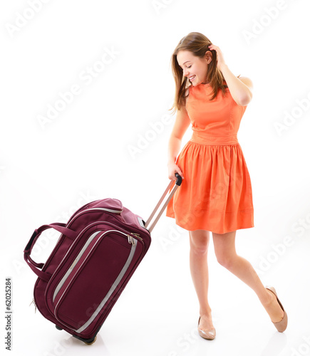 Happy teen girl with travel bag over white