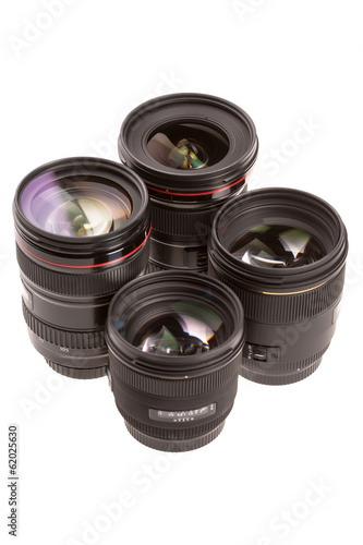 Several photographic lenses isolated on white background.