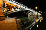 Triana Bridge over Guadalquivir river at sunset with river refle - 62026615
