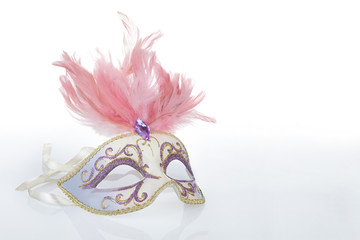 Beautiful carnival mask with pink feathers