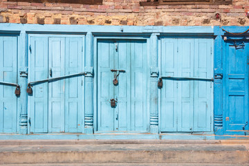 Blue doors locked with padlocks