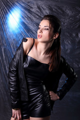 Sexy woman in leather costume