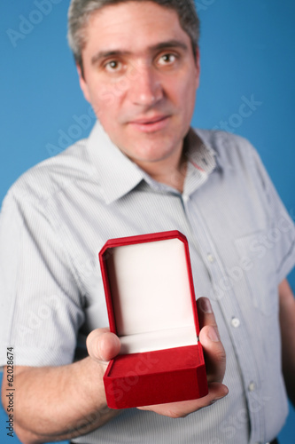 man with an open red gift box