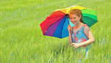 girl with umbrella on field