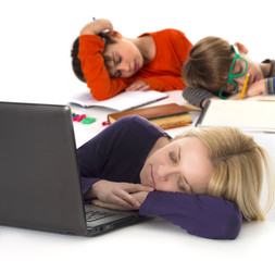 mother and kids asleep on table while working