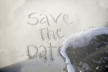 save the date, in sand