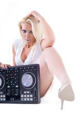Sexy girl posing with audio equipment