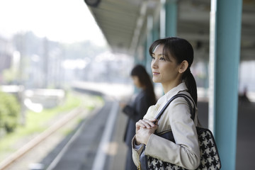 woman waiting for train on the platform