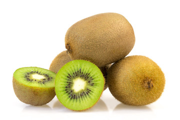 Three kiwi and kiwi with cut