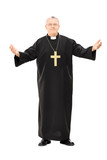 Mature reverend in black mantle with open hands