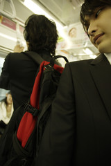 man carrying big bag on his back in train