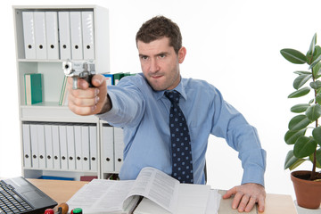 businessman shooting the gun
