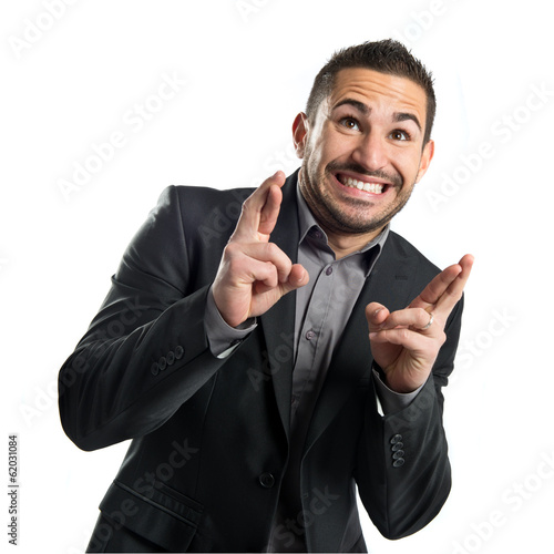 Young businessman with his fingers crossing
