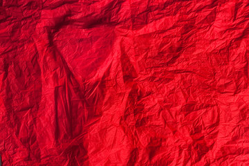 Silhouette of the heart on a red crumpled paper