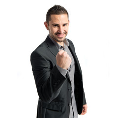 Young business man winner over white background