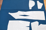 paper model of apparel on fabric for cutting poster