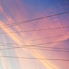 electrical power cables and pink sunset clouds