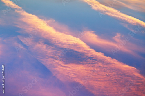 pink sunset clouds in blue spring sky