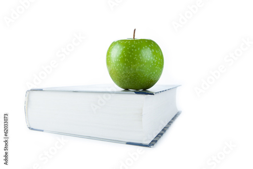 large book with green apple
