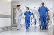 Doctors Hospital Corridor Nurse Pushing Gurney Stretcher Bed