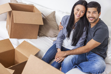 Asian Chinese Couple Unpacking Boxes Moving House